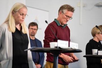 Anders Tegnell, the state epidemiologist of the Public Health Agency of Sweden checks his mobile phone during a news conference about the daily update on the coronavirus disease (COVID-19) situation, in Stockholm