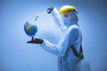 Scientist spraying Earth globe to decontaminate planet from viruses and germs.