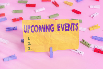 Handwriting text writing Upcoming Events. Conceptual photo the approaching planned public or social occasions Colored clothespin papers empty reminder pink floor background office pin