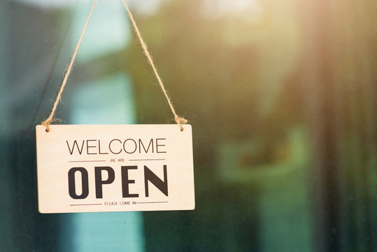 WELCOME WE ARE OPEN PLEASE COME IN notice sign wood board label hanging through glass door