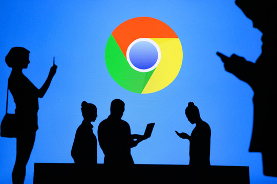 NEW YORK, USA, 25. MAY 2020: Google Chrome web browser developed by Google Group of business people chat on mobile phone and laptop. Company logo on screen in background