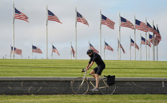 A cyclist wears a face mask at the Washington Monument during the coronavirus disease (COVID-19) pandemic in Washington