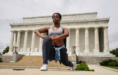 Jessica Beaugris, a nurse who deals with the dangers of the coronavirus disease (COVID-19) on a daily basis, exercises on the steps of the Lincoln Memorial in Washington