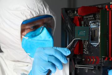 Man in uniform sets microchip electronic equipment Wall mural