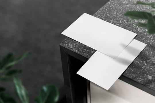 White minimal business card mockup on grey stone and light. PSD file.