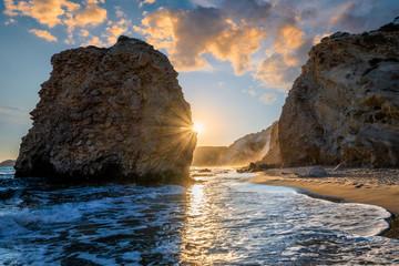 Fyriplaka beach and waves of Aegean sea on sunset, Milos island, Cyclades, Greece