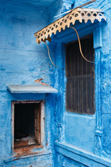 Windows in blue house facade in streets of of Jodhpur, also known as Blue City due to the vivid blue-painted Brahmin houses, Jodhpur, Rajasthan, India
