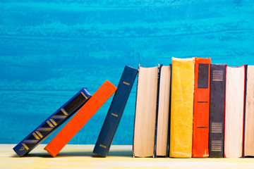 Books on wooden desk table and abstract background. Education background. Copy Space. Back to...