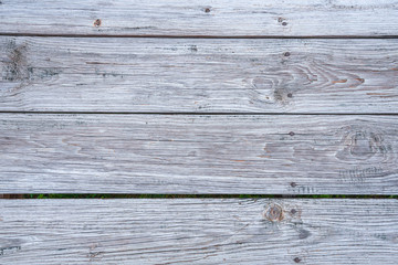 Close up of the weather planks of a boardwalk. Useful as wooden background
