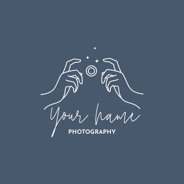 Linear logo of the photographer. Women's Hands hold the camera shutter. Vector logol for a photo Studio