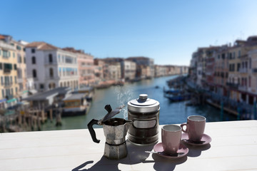 coffee for two from the rialto bridge - view of venice canal grand