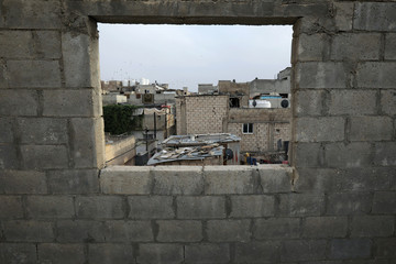 A view of Al-Baqaa camp as seen from the roof's window of Jordanian brothers Hussein and Zeyad Ashish at Al-Baqaa Palestinian refugee camp, near Amman