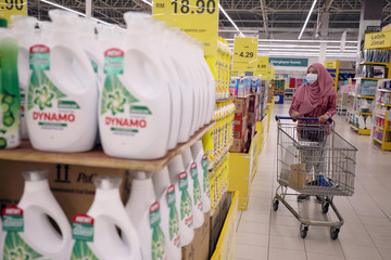 A woman wearing a protective face mask shops at a supermarket, amid the coronavirus disease (COVID-19) outbreak in Kuala Lumpur