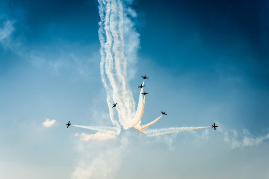 Formation of air planes on the blue cloudy sky during the airshow
