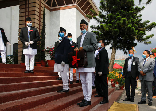 Nepal?s Finance Minister Yuba Raj Khatiwada displays his briefcase to the media upon his arrival at the parliament, in Kathmandu