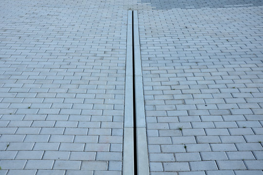 drainage element in interlocking paving concrete gutter with slotted drain from one piece of concrete