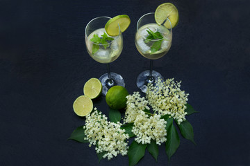 "Cocktail ""Hugo"" with elder flowers on black slate, copy space"