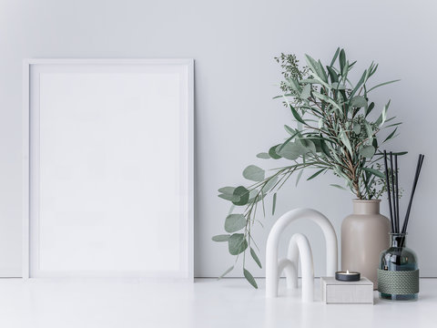 Interior poster mockup with vertical white wooden frame on white wall with Eucalyptus plant branch with green leaves. 3D rendering.