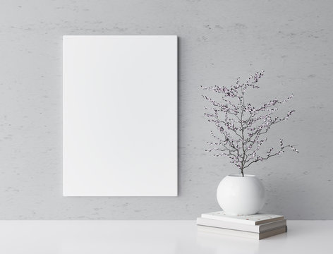 White frame and home decoration on gray wall with white flower vase and books, artwork poster mock-up
