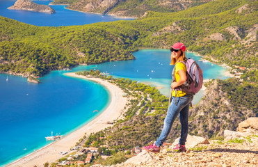 Sporty hiking girl over Oludeniz lagoon in sea landscape view of beach, Turkey. Travel and healthy lifestyle