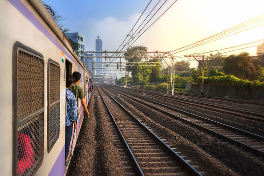 Mumbai, India, Due to overcrowding, people travel in open doors. Mumbai Suburban Railway known as Super-Dense Crush Load and most severe overcrowding in the world