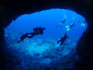 scuba diver cave dive underwater exploring blue caves ocean scenery Wall mural