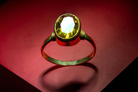 Golden Ring with yellow sapphire stone. Image of a jewelry which can be used as a background image or illustration.