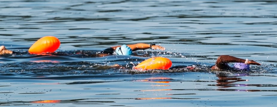 Two African American women swim training together in the sea