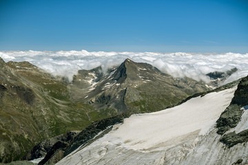 Wall Mural - Clouds stopped by majestic Alps near Saas-Fee, Switzerland