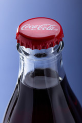 Belgorod , Russia - MAY, 28, 2020: top view of red cap from the glass bottle of Coca-Cola. Classic Bottle Top. Popular Carbonated soft drink produced by Coca-Cola.