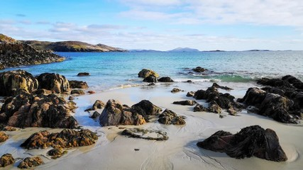 Wall Mural - Gentle waves breaking on the shore at Hushinish on the Isle of Harris in the Outer Hebrides of Scotland