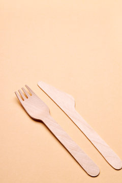 eco-friendly disposable utensils concept. bamboo or wooden cutlery over color background.