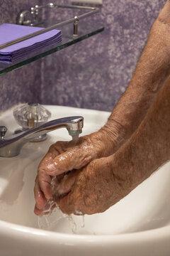 Hands under running water faucet water dripping