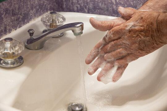 Soapy hands bathroom sink drain horizontal