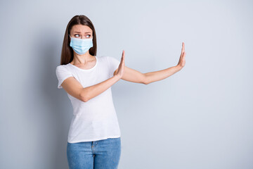 Too close. Photo of serious lady keep social distance avoid afraid of people contact raise arms side empty space stand two meter wear protect face mask isolated grey color background