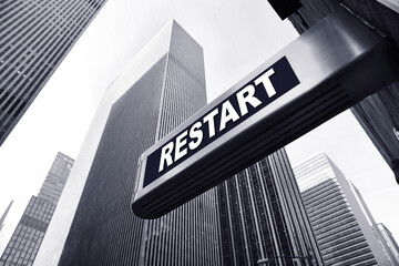 office building with a restart sign