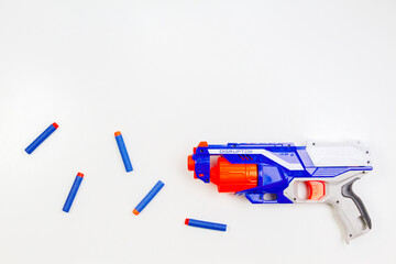 Vilnius, Lithuaania - March 5, 2019: Nerf N-Strike Elite Disruptor Blaster and Refill Bullet Darts on white background