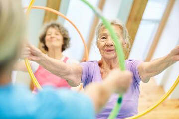 Seniors do gymnastics with hoops