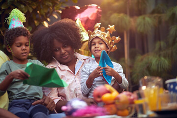 Afro-american girl celebrate birthday party.Fun time to happy family.