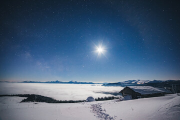 Wall Mural - View at the starry sky over snowy hills. Location place Carpathian mountains, Ukraine, Europe.