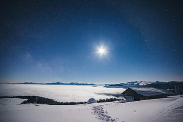 壁紙(ウォールミューラル) - View at the starry sky over snowy hills. Location place Carpathian mountains, Ukraine, Europe.