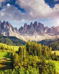Wall Mural - Countryside view of the Funes valley St. Magdalena or Santa Maddalena in the National park Puez Odle or Geisler. Dolomites, South Tyrol. Location Bolzano, Italy, Europe. Dramatic scene. Beauty world.