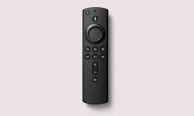 Fototapeta Black smart remote control on a white background obraz