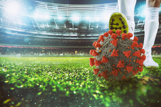 Soccer player with virus ball under the football shoe at the stadium