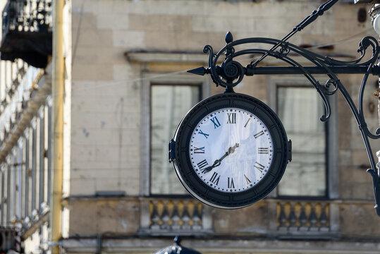 Russia, Saint Petersburg, may 23, 2020: wall-mounted large street clock retro