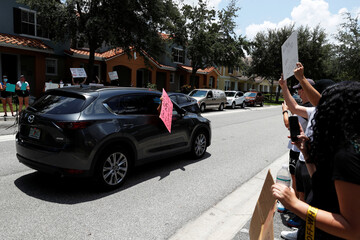 Protesters drive by the Florida home of former Minneapolis police officer Derek Chauvin, in Orlando
