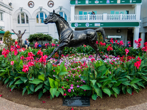The statue of Aristides surrounded by flowers in the paddock at Churchill Downs.