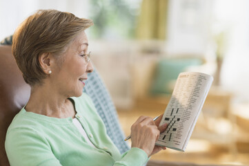 Senior woman doing crossword puzzle