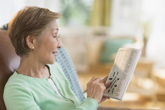 Senior woman doing crossword puzzle