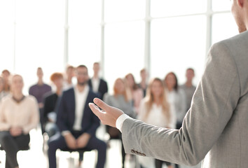 image of a speaker giving a lecture at a business seminar